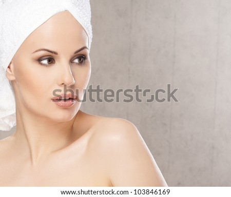 Spa portrait of young attractive woman in towel - stock photo