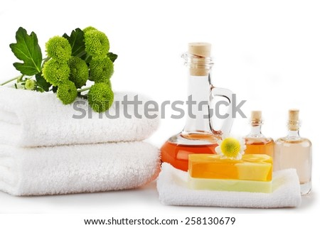 Spa products and candlelight  - stock photo