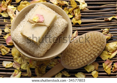 Spa products bath soap and brush on mat - stock photo