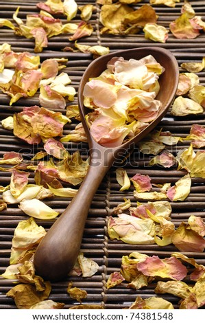 Spa products bath soap and brush with spoon on rose withered petals - stock photo