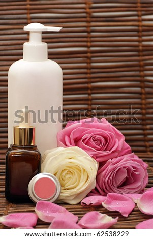 Spa products, cosmetics, accessories, pink and white roses