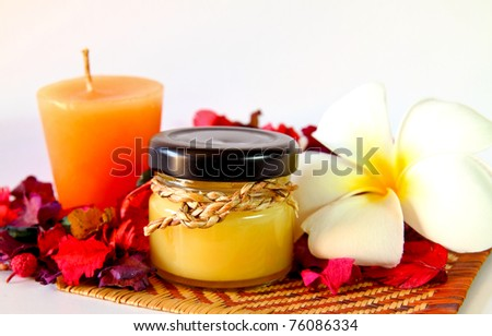Spa products with flowers and candles - stock photo