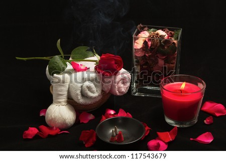 Spa red rose setting with thai incense and candlelight - stock photo