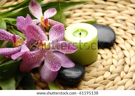Spa resort composition - candles, orchid flowers, zen stones - stock photo