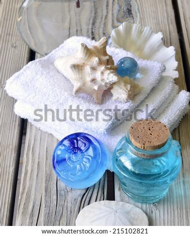 Spa salon towel shell aromatherapy treatment relaxation. - stock photo