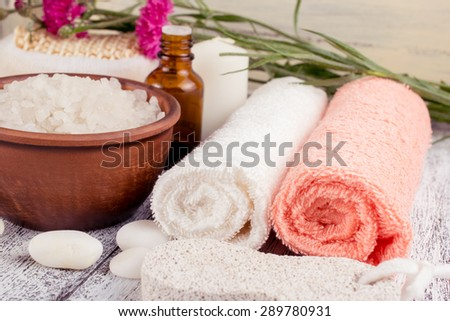 Spa salon with sea salt, towels and flowers. For this photo applied color toning effect.  - stock photo
