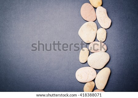 Spa salt and stones for beauty and health. Healthy relaxation, therapy and treatment. Aromatherapy, body care, aroma massage. Alternative lifestyle. Relax in bath. - stock photo