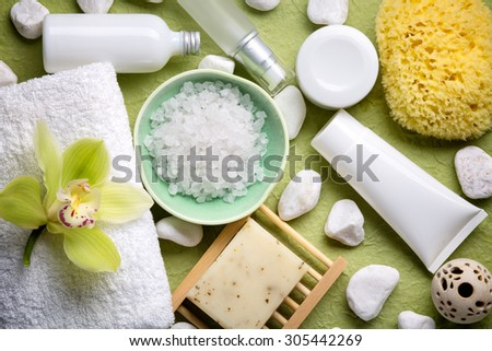 Spa salt,essential oil,towel and blooming orchid. - stock photo