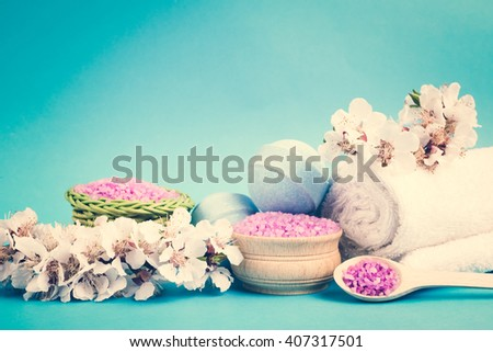 Spa salt, flower branch, bath bomb, towel for beauty and health. Healthy relaxation, therapy and treatment. Aromatherapy, body care, aroma massage. Alternative lifestyle. Relax in bath. - stock photo