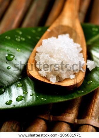 Spa Salt in wooden spoon closeup. Bath salt. Sea Spa treatments  - stock photo