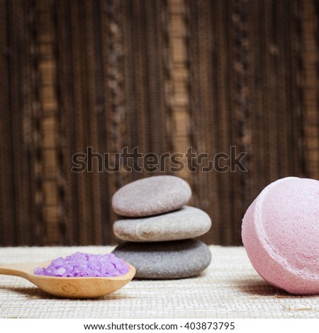 Spa salt, stones and bath bomb for beauty and health. Healthy relaxation, therapy and treatment. Aromatherapy, body care, aroma massage. Alternative lifestyle. Relax in bath. - stock photo