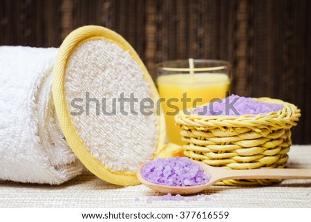 Spa salt, wisp, towel, wisp and candle for beauty and health. Healthy relaxation, therapy and treatment. Aromatherapy, body care, aroma massage. Alternative lifestyle. Relax in bath. - stock photo