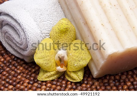 Spa Scene with Towel, Orchid and Soap. - stock photo