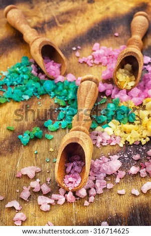 Spa.Sea salt for Spa relaxation treatments on the background of wooden scoops - stock photo