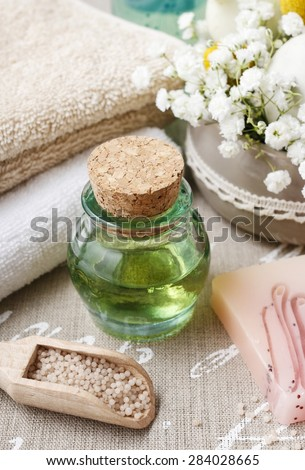 Spa set: bottle of essential oil, soft towels, bar of natural, handmade soap - stock photo