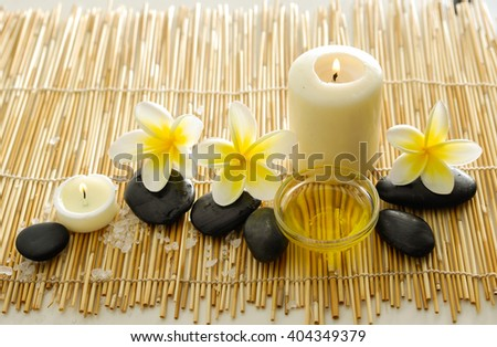 Spa set on bamboo mat with white salt.candle - stock photo