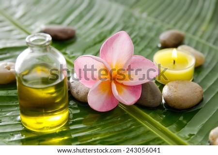 Spa set on banana leaf with pebbles - stock photo
