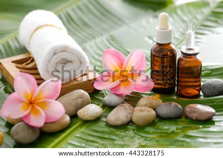 Spa set on banana leaf with pebbles - stock photo