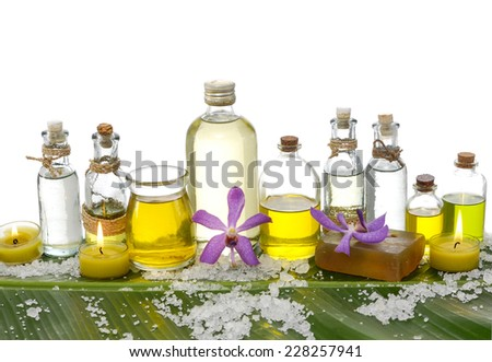 Spa set on banana leaf with pile of salt - stock photo