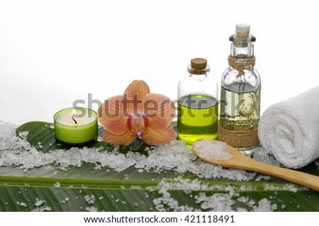 Spa set on banana leaf with pile of salt - stock photo