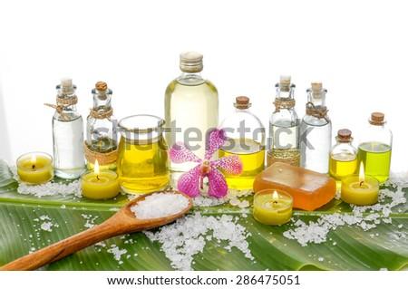Spa set on banana leaf with pile of salt ,many oil - stock photo