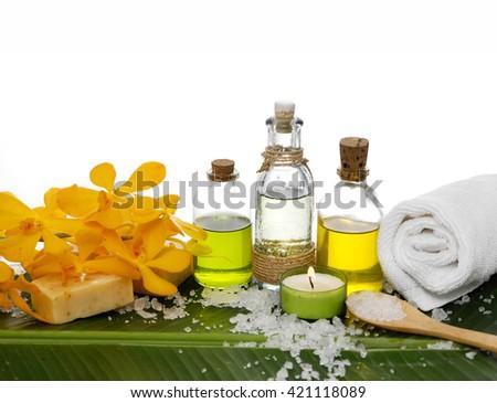 Spa set on banana leaf with white pile of salt - stock photo