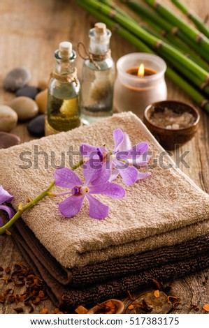 Spa set on old wood with grove, orchid