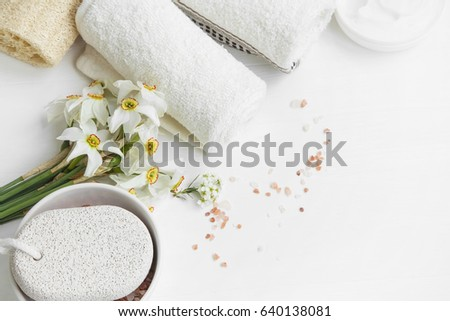 Spa set still life with daffodils, pumice stone,towels and bath salt, top view