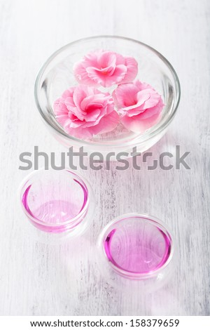 spa set with begonia flowers and essential oil