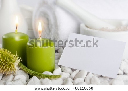 Spa set with candles and blank paper card with copyspace - stock photo