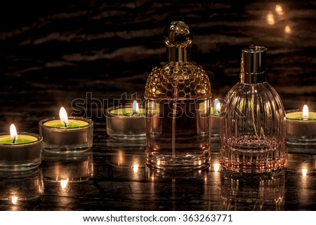Spa set with candles and bottles of parfum - stock photo