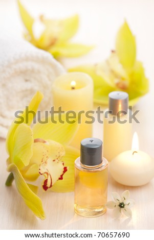 spa set with essential oils and flowers - stock photo