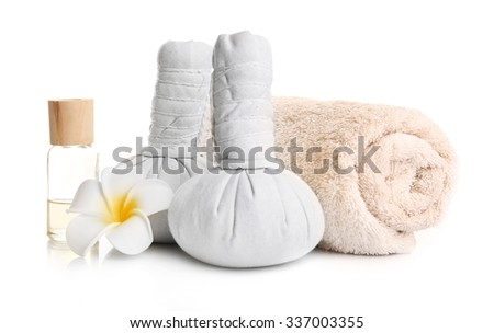 Spa set with massage balls, towel, aroma oil and frangipani flower isolated on white - stock photo