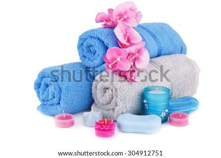 Spa set with towels, candles, soaps and flowers isolated on white background. - stock photo