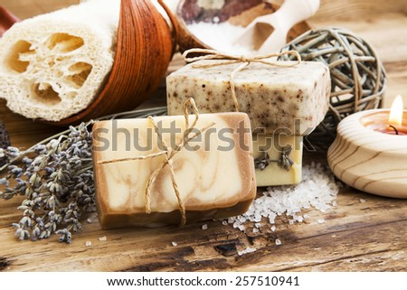 Spa Setting.Homemade Natural Soaps with Coffee, Honey and Lavender, Burning Candle - stock photo