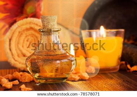 Spa setting  in orange tones  with candles - stock photo