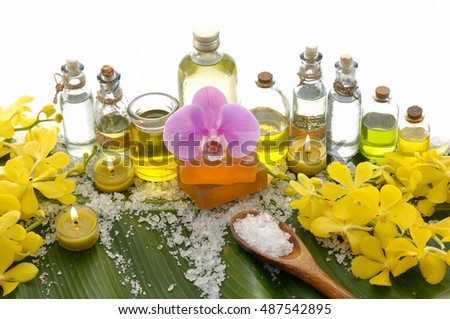 Spa setting on banana leaf with yellow orchid ,soap