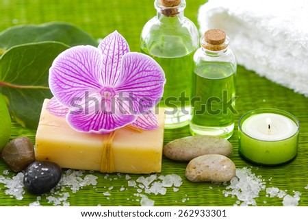 Spa setting on green mat - stock photo