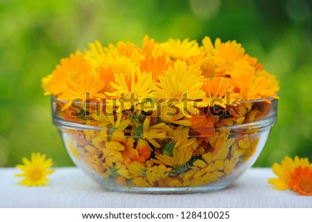 Spa setting, treatment with calendula flowers - stock photo