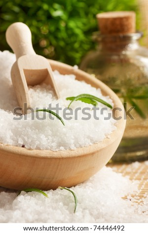 Spa setting with bath salt and floral water.