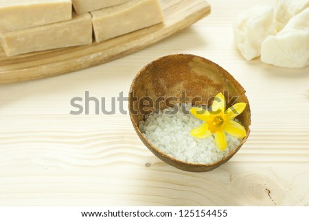 spa setting with bath salts and soaps on wooden - stock photo
