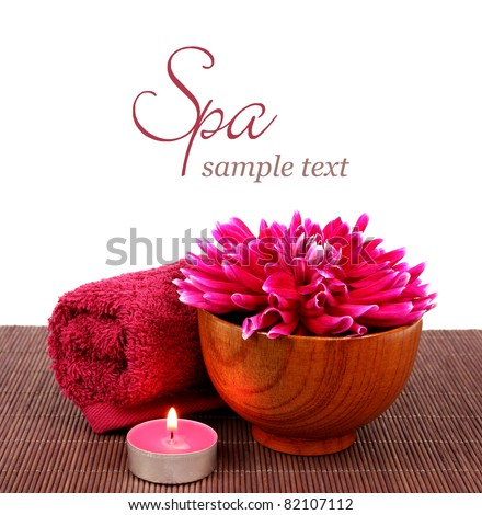 Spa setting with beautiful pink flower, towel, candle over white background