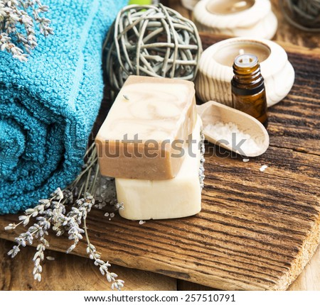 Spa Setting with Bodycare Products.Natural Soap with Lavender Flowers and Essential Oil Bottle - stock photo