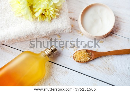 Spa Setting with Essence Oil,Natural Soap  and Sea Salt with flower    on  white  wooden background  - stock photo
