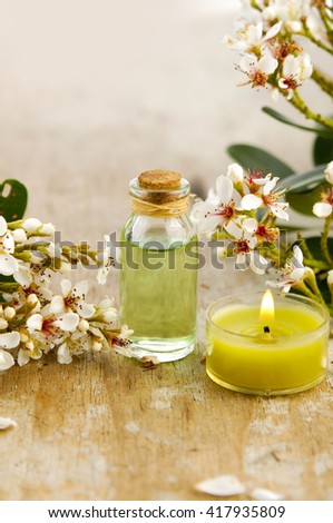 Spa setting with flower ,candle, oil on wood - stock photo