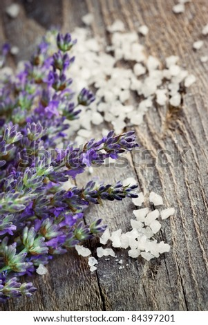 Spa setting with Fresh lavender over wooden background with bath salt - stock photo