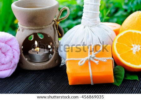 Spa setting with handmade orange soap.
