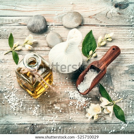 Spa setting with jasmine essential oil and flowers. Wellness concept, top view