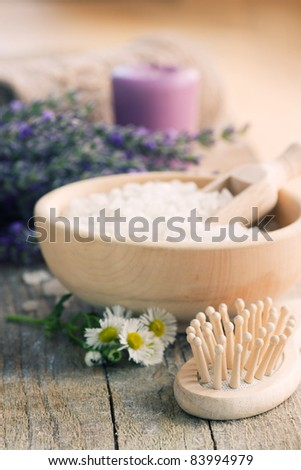 Spa setting with lavender,bath salt, hair brush, candle,  and natural soap - stock photo
