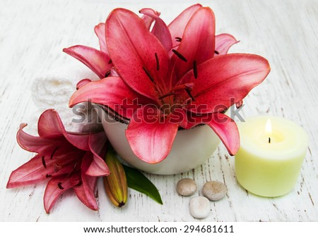 spa setting with lily flower on a old wooden background - stock photo